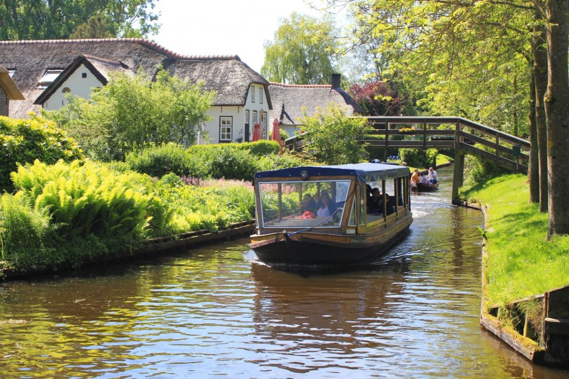 canal cruise giethoorn bunch of backpackers be careful on the steep
