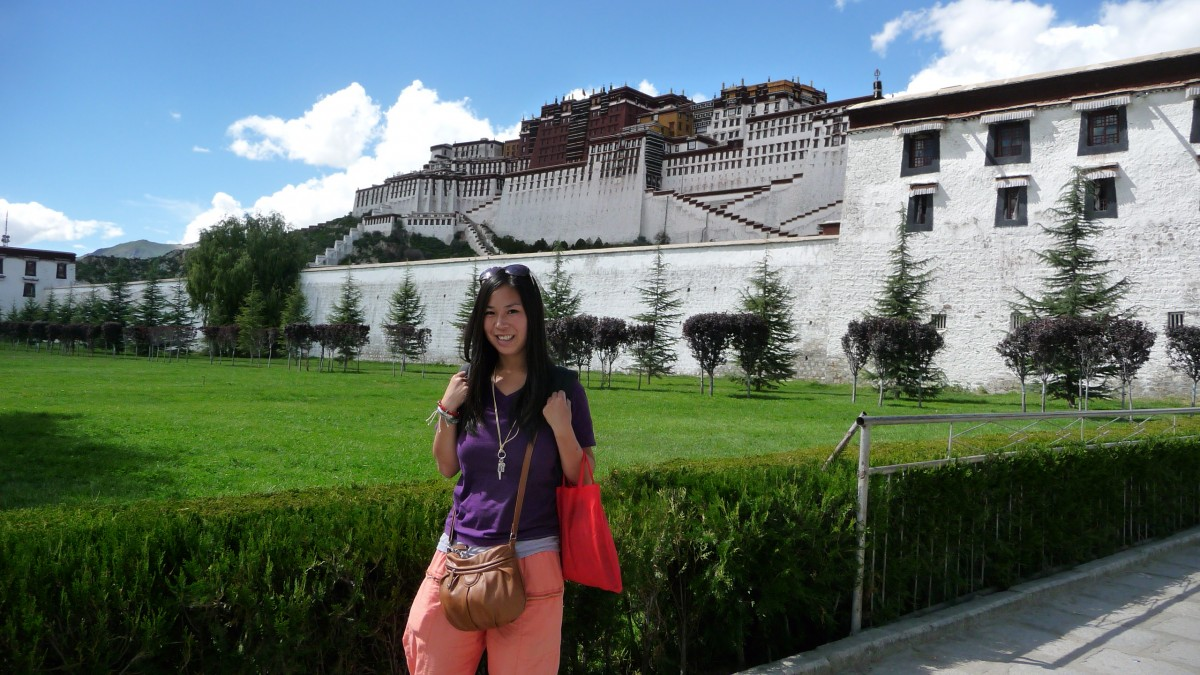 24-year-old Manouk in front of the Potala Palace in Lhasa, Tibet.