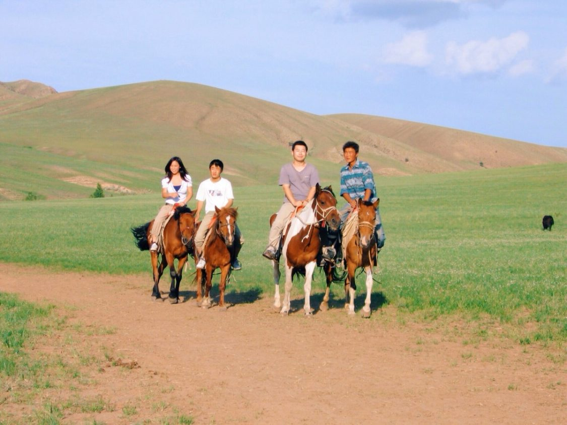 Horseriding on the grasslands of Innermongolia. ©Bunch  of Backpackers.