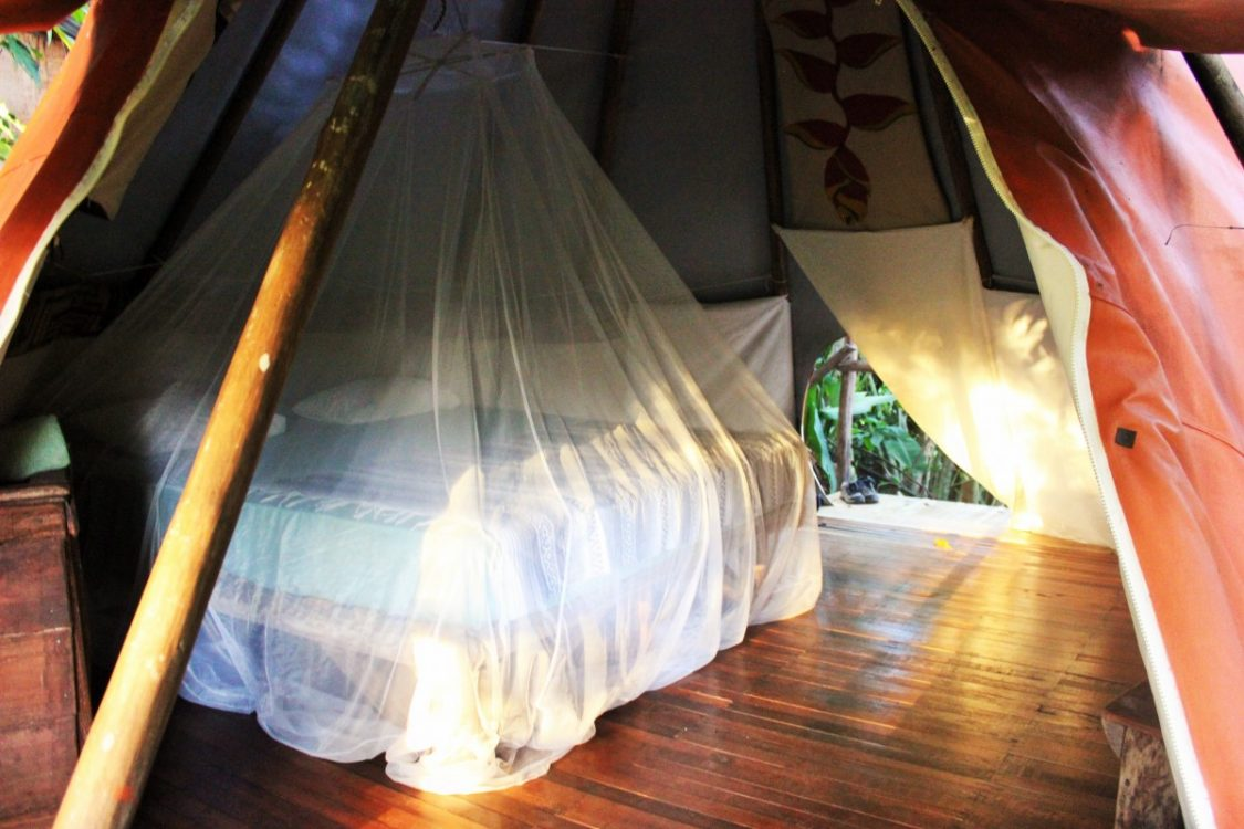 Spreading out on the eco mattress inside the comfort of the tipi. ©Charlie on Travel