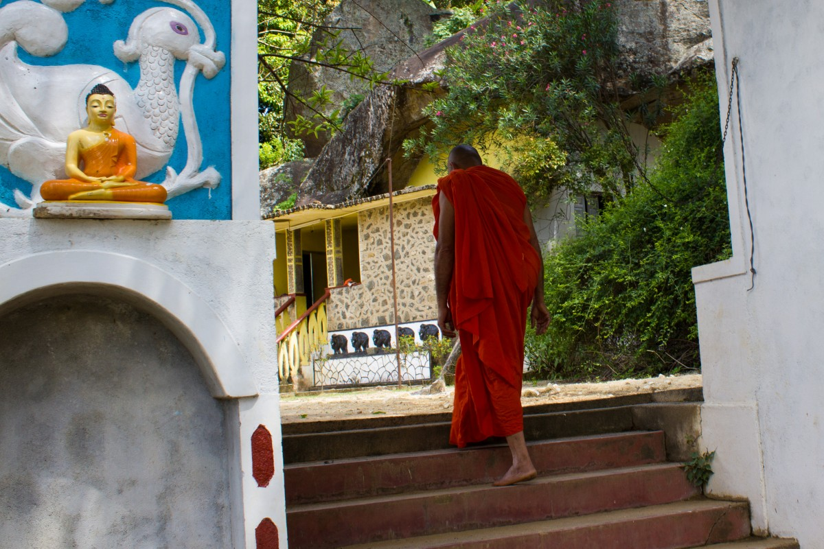Monk entering a temple, Sri Lanka