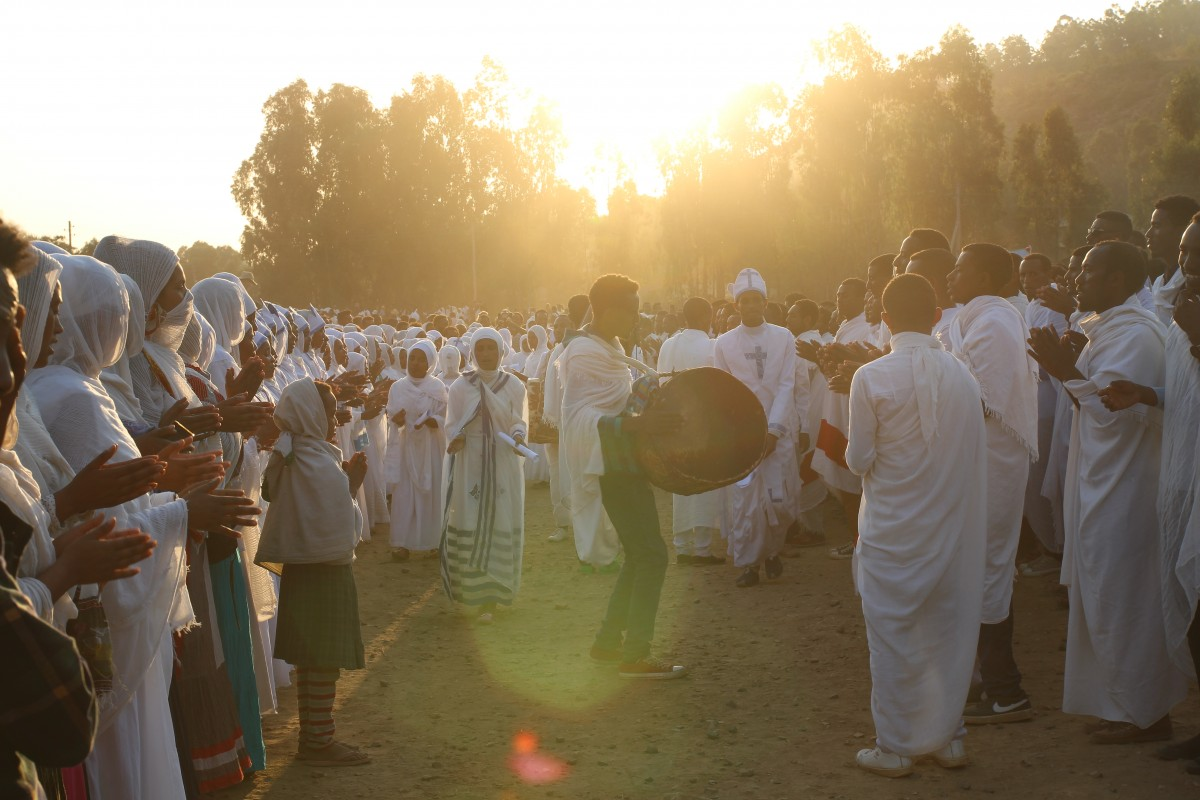 Sunset during the Timkat Festival in Ethiopia, but the chanting and dancing continues. Timkat festival Ethiopia. Copyright Bunch of Backpackers