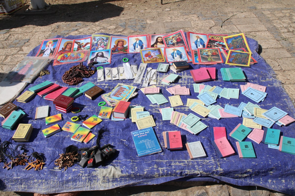 Books and bracelets for sale in Aksum. Timkat Festival Ethiopia.